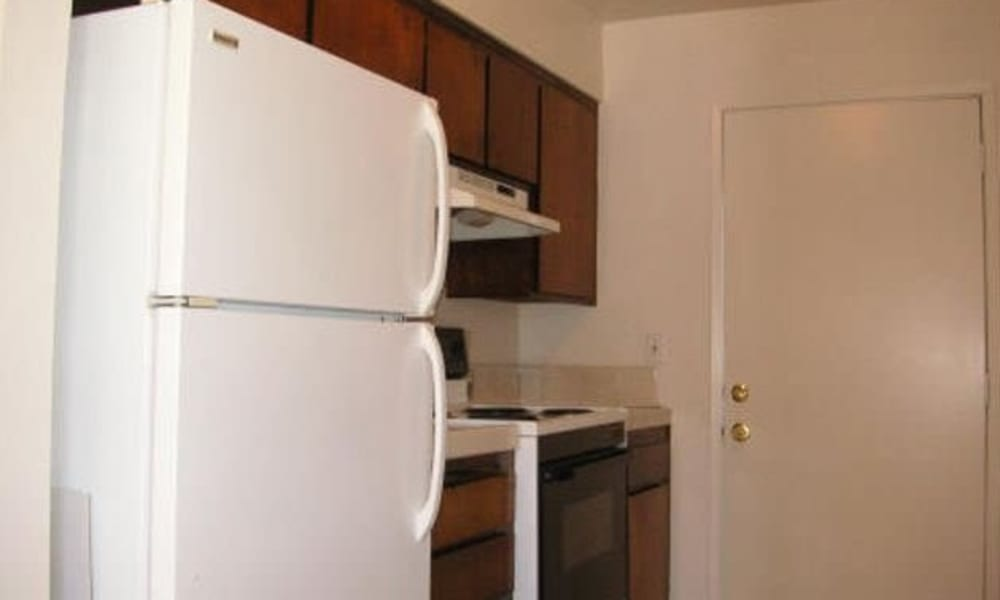 Modern kitchen in a model apartment at Olympus Court Apartments in Bakersfield, California