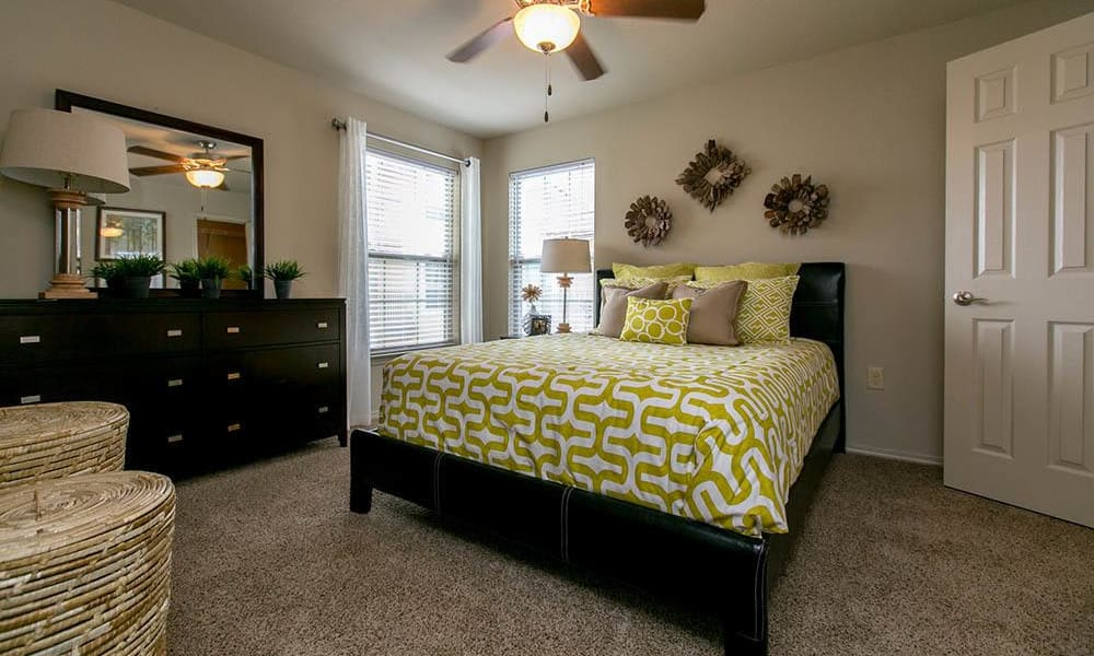 Bedroom with plush carpeting at Tuscana Bay Apartments in Corpus Christi, Texas
