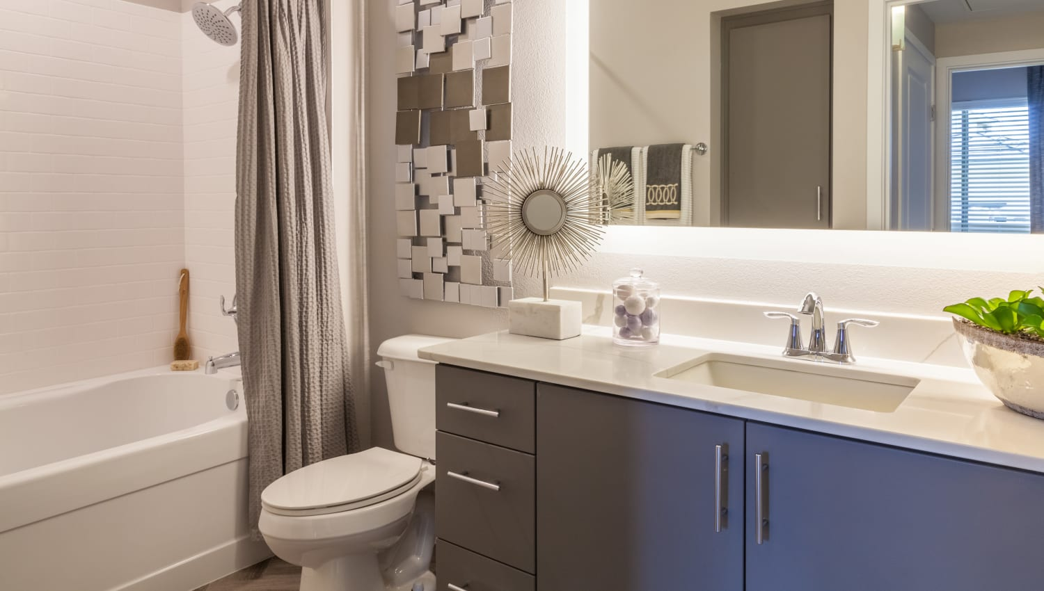 Model bathroom with bath and shower at Olympus Alameda in Albuquerque, New Mexico