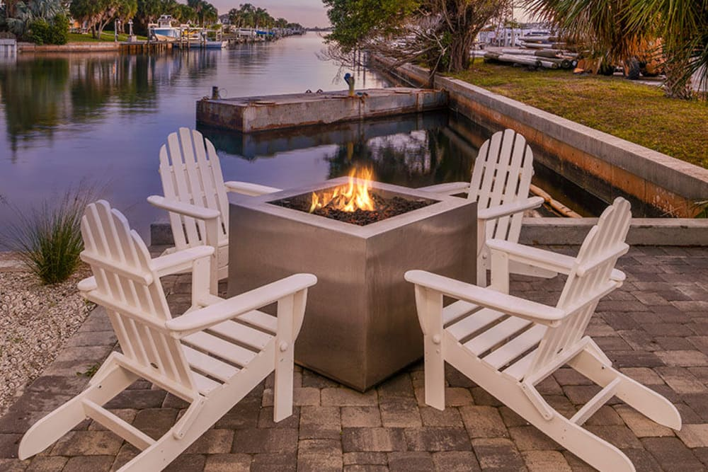 Seating next to outdoor fire pit in South Pasadena, Florida at Sailpointe Apartment Homes