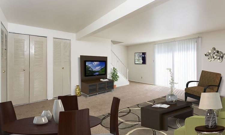 Enjoy family time in your new living room at High Acres Apartments & Townhomes in Syracuse, New York