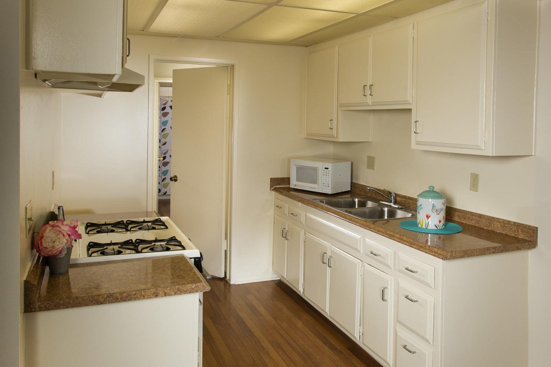Kitchen with hardwood floors at Chatham Village in Tustin, California