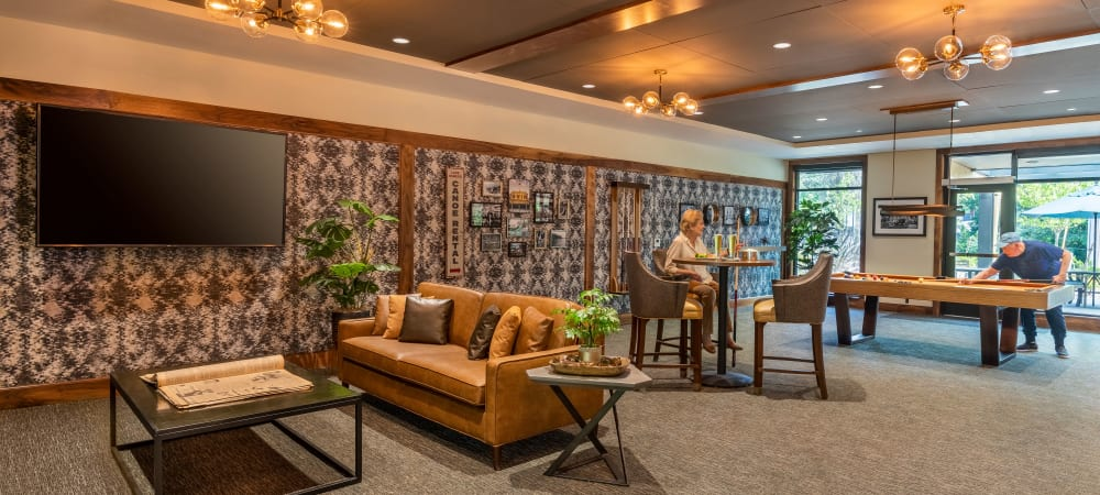 Activity lounge with games, a bar, and tv's at The Springs at Lake Oswego in Lake Oswego, Oregon