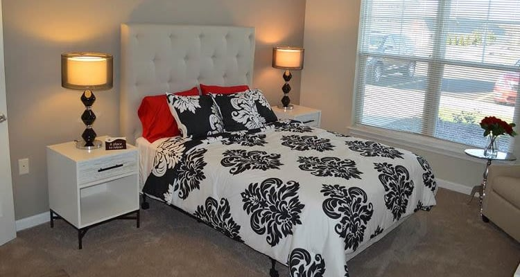 Beautifully designed bedroom at Rivers Pointe Apartments in Liverpool, NY