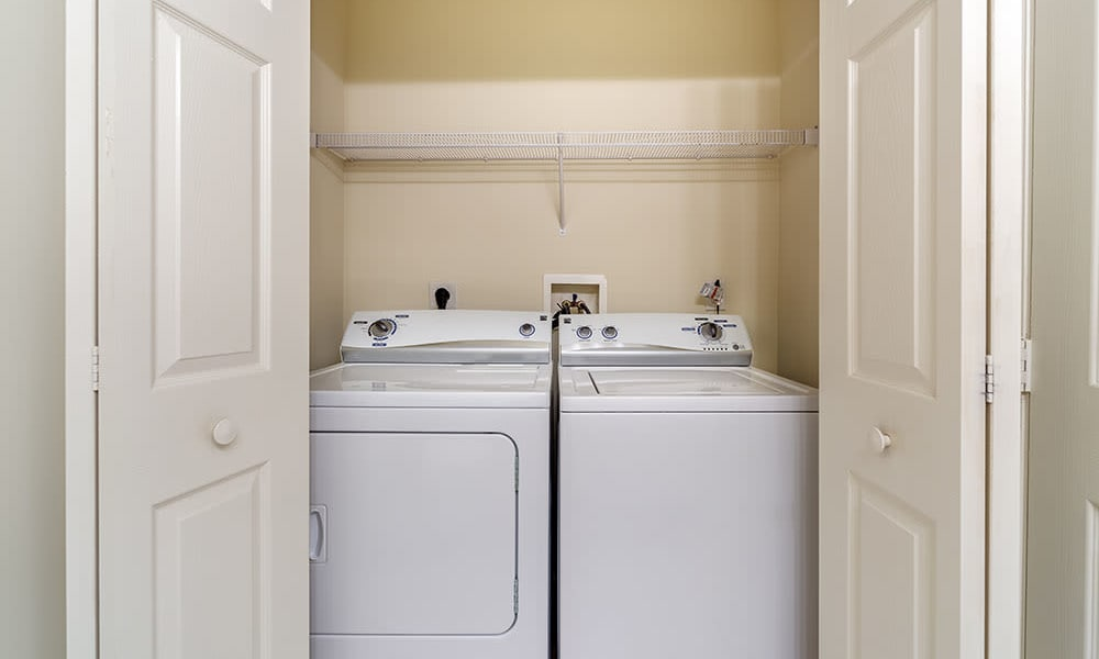 washer and dryer in apartment at The Waterfront Apartments