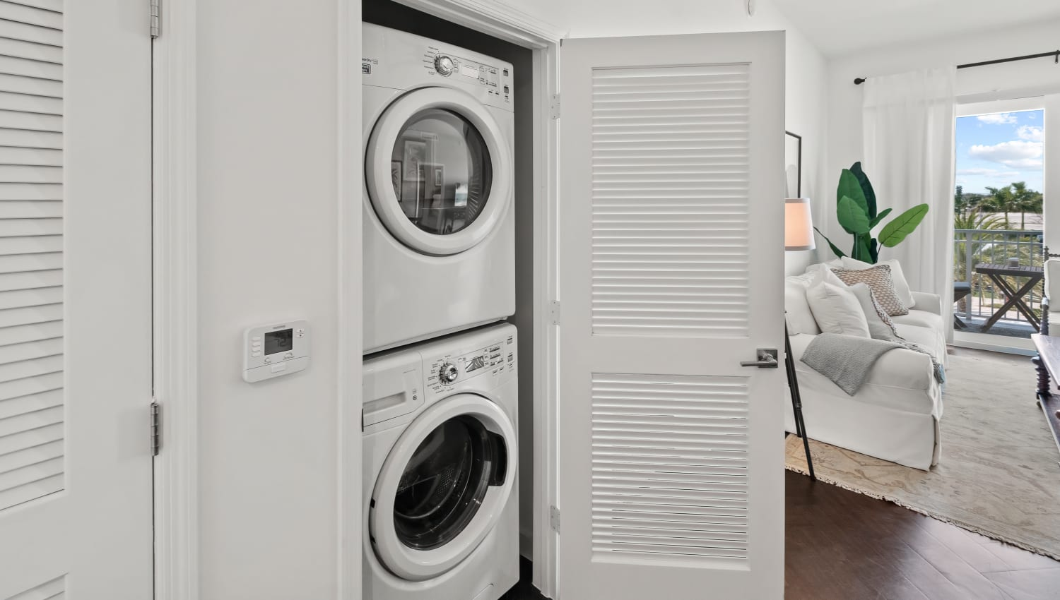 Washer and dryer in a model apartment home at Town Lantana in Lantana, Florida