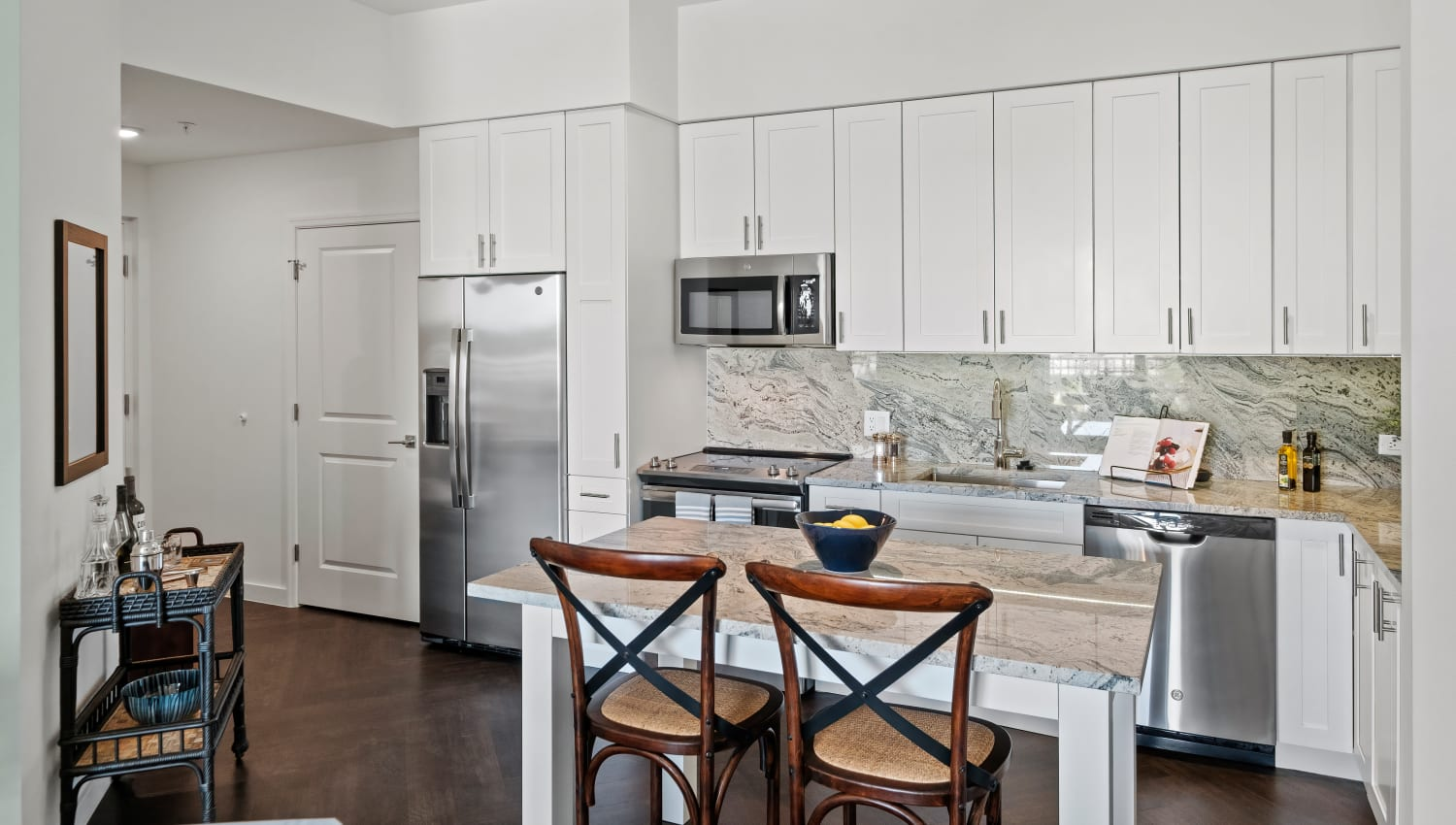 Model kitchen with adaptable island and stainless steel appliances at Town Lantana in Lantana, Florida