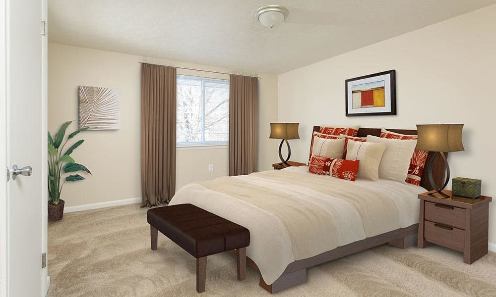 Well decorated bedroom at Willowbrooke Apartments and Townhomes home in Brockport, NY