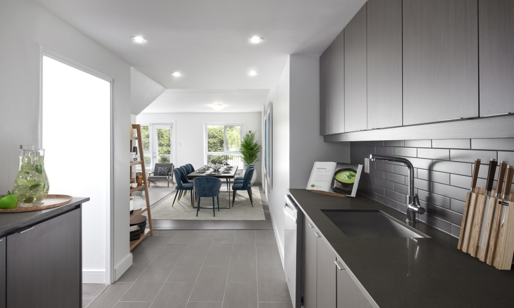 Model kitchen with dark cabinetry at Bayview Mews in North York, Ontario