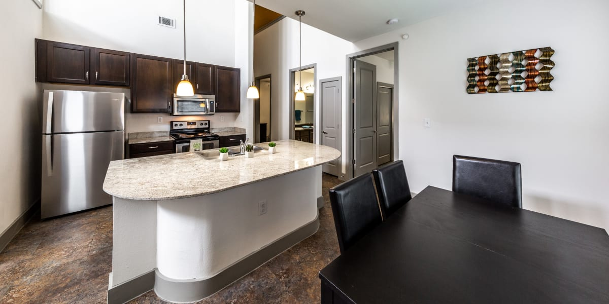 Dining room and kitchen at Regents West at 26th in Austin, Texas