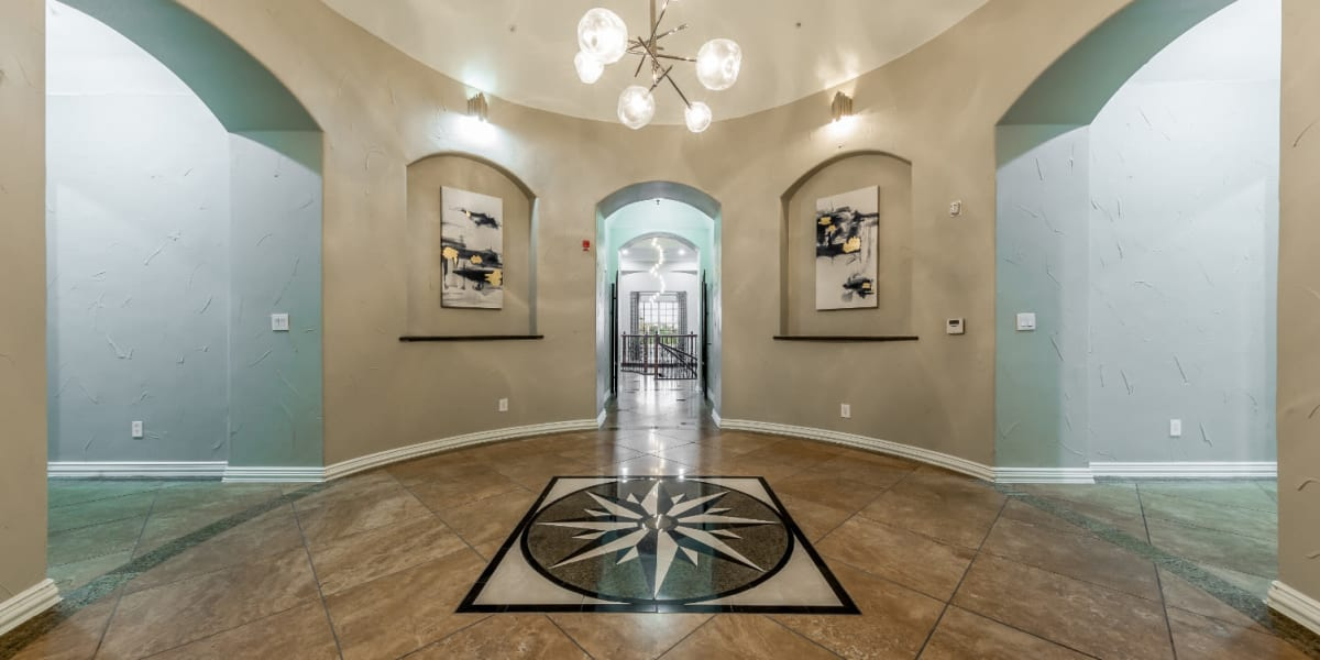 Community clubhouse entrance with decorations and artwork at Marquis at Stone Oak in San Antonio, Texas