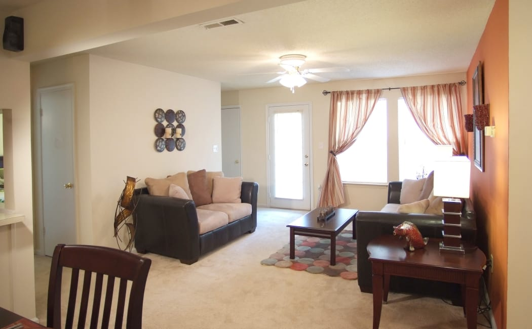 Living room in model home at Woodbriar Apartments in Chesapeake, VA