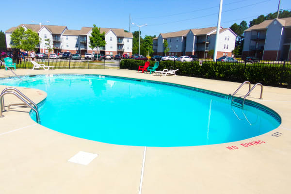 Enjoy a swimming pool at Brookstone Apartments in Fayetteville, North Carolina