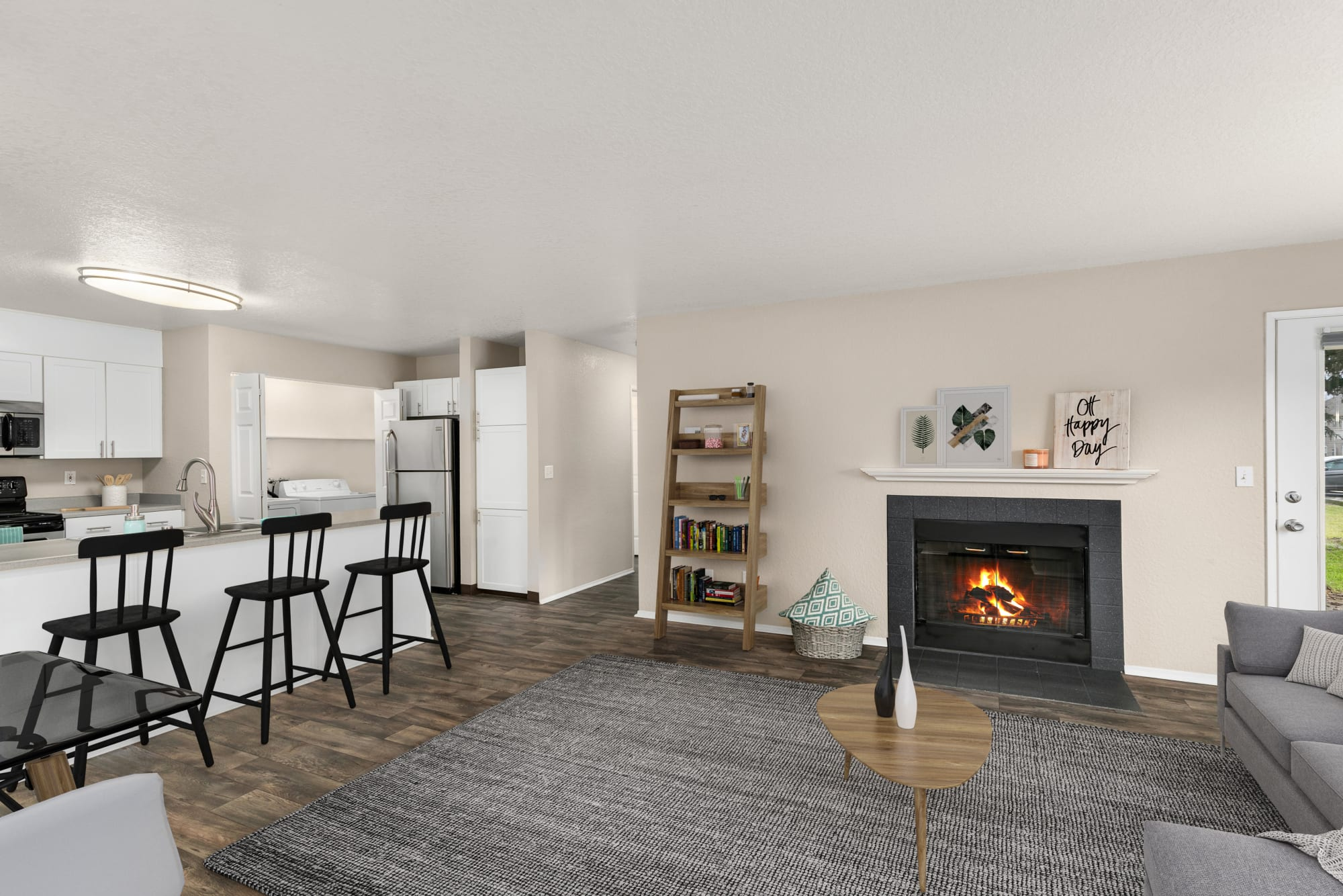 Living room with a fireplace and hardwood-style floors at Carriage Park Apartments in Vancouver, Washington