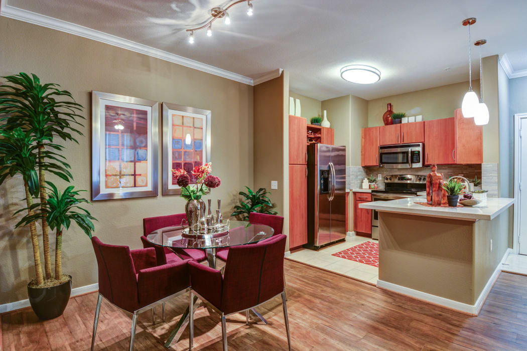 Kitchen view from the dining area of model home at San Paloma Apartments in Houston, Texas