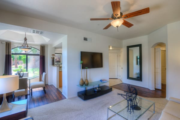 Large living room with ceiling fan at San Lagos in Glendale, Arizona