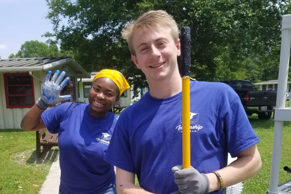 Coworkers volunteering together near Harbor Group Management in Norfolk, Virginia