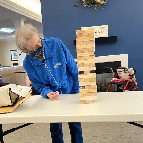 Resident playing Jenga at Madison House in Norfolk, Nebraska