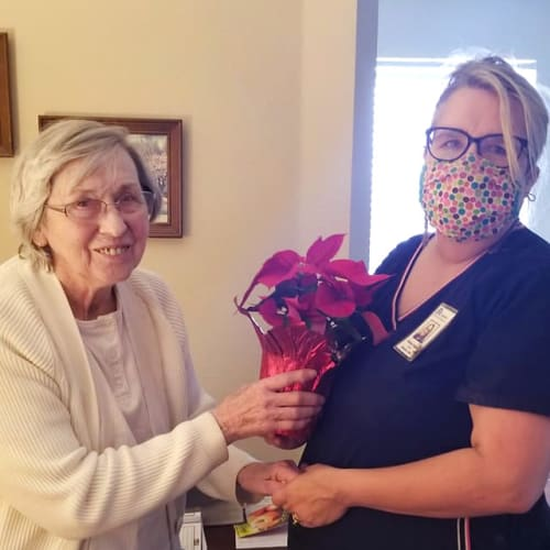 A resident receiving flowers at Creekside Village in Ponca City, Oklahoma