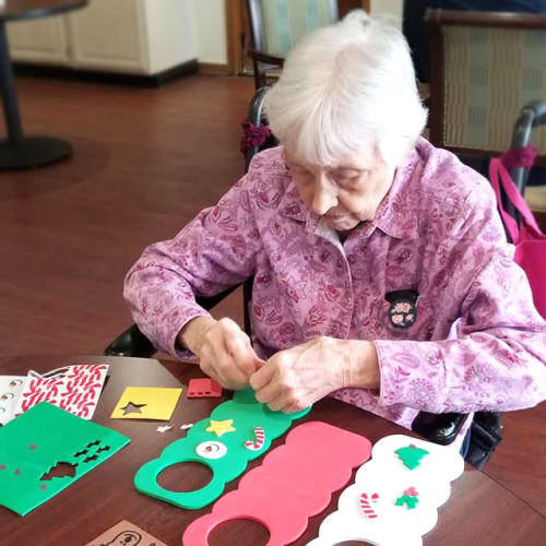 A Resident making decorative door hangers at Creekside Village in Ponca City, Oklahoma