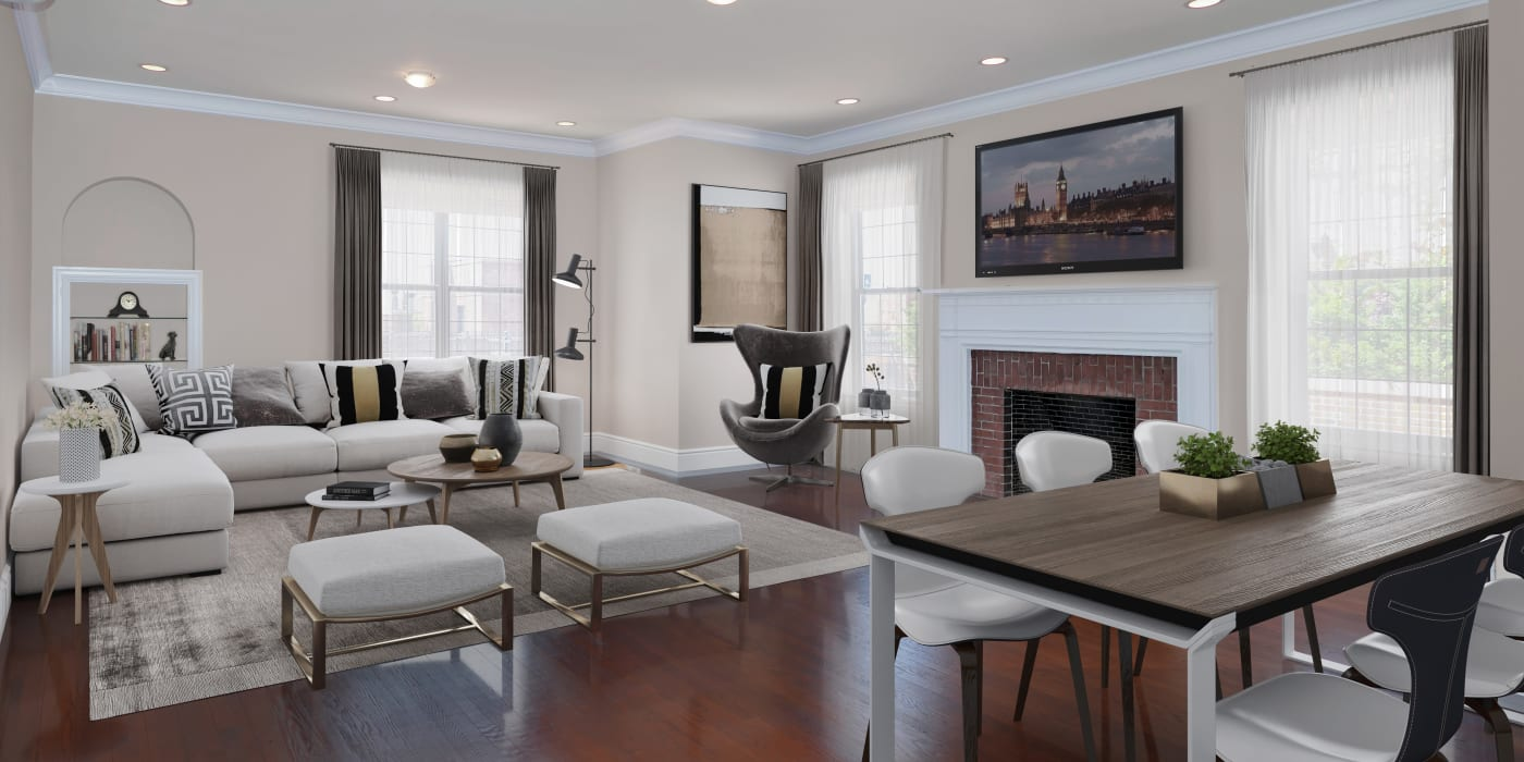 Large living room with a fireplace at London Terrace Gardens in New York, New York