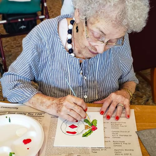 A resident painting with watercolors at Canoe Brook Assisted Living & Memory Care in Catoosa, Oklahoma
