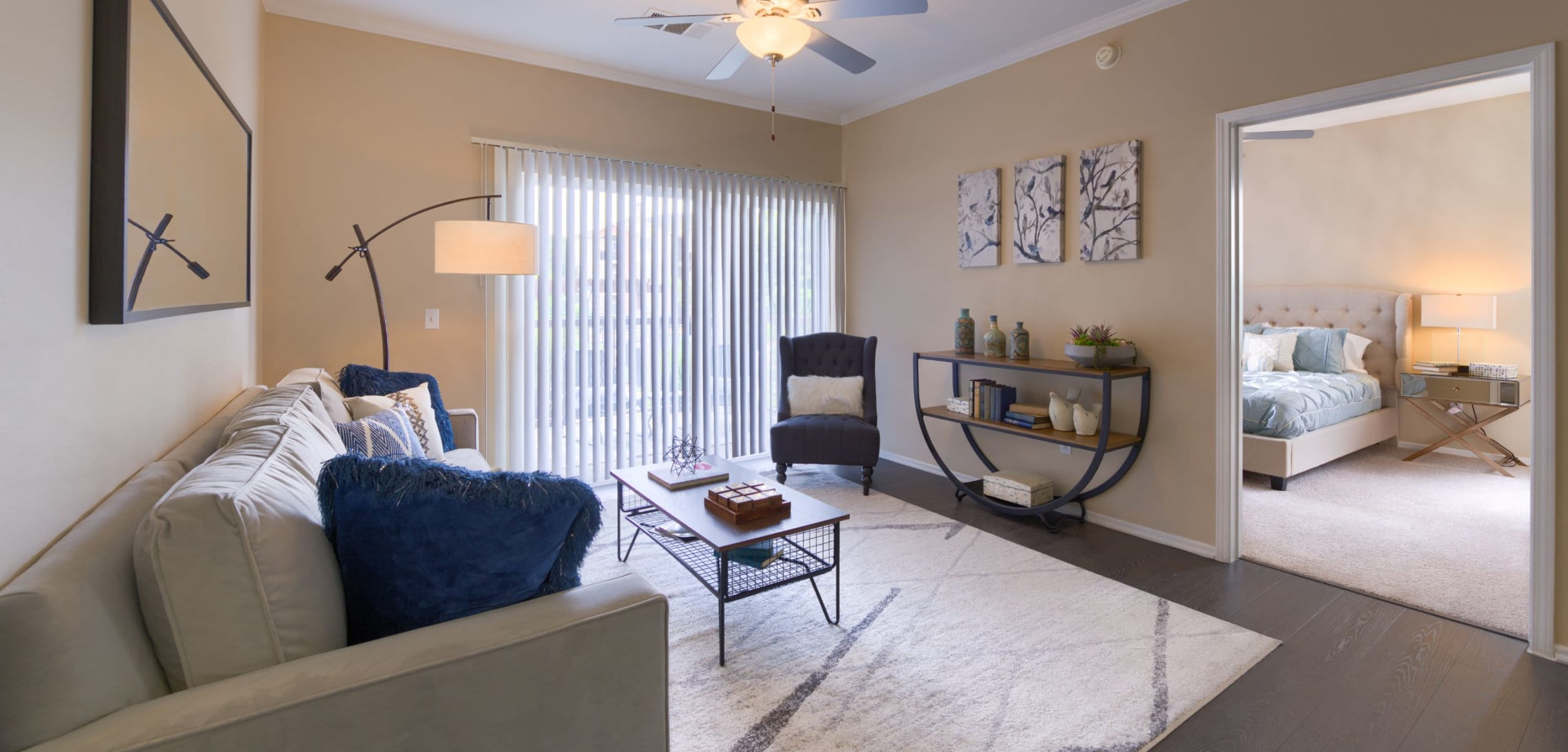 Spacious living room with wood style floors at Whisper Creek Apartment Homes in Lakewood, Colorado