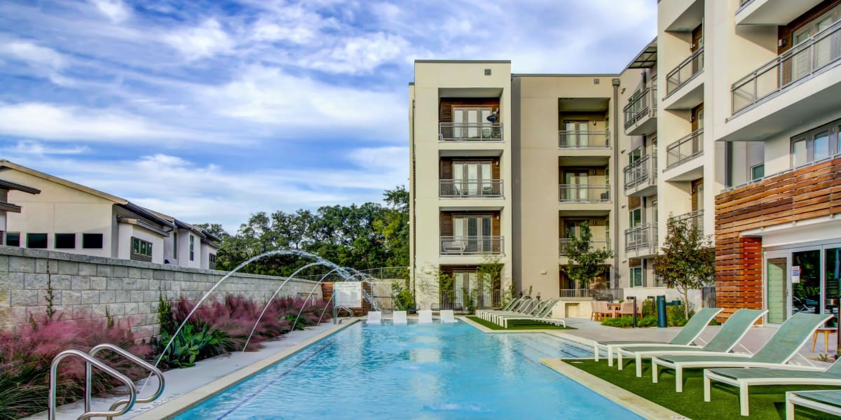 Resort style pool with a water feature at Westerly 360 in Austin, Texas