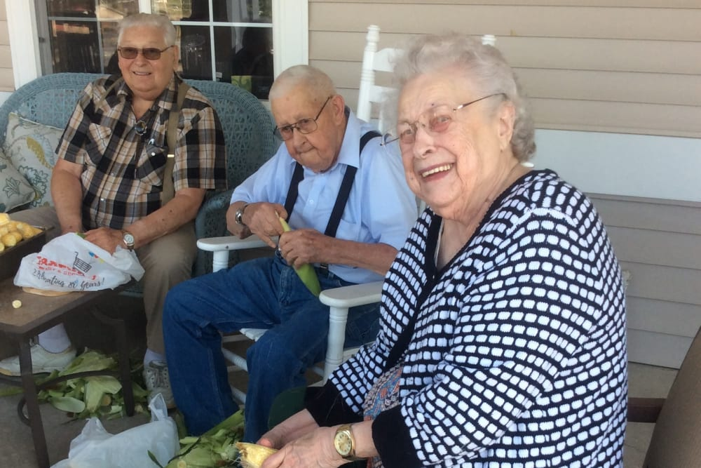 Residents enjoying an activity on the porch at Clover Ridge Place in Maquoketa, Iowa.