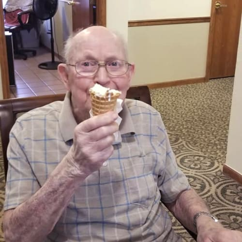 Resident enjoying a waffle cone of ice cream at Creekside Village in Ponca City, Oklahoma