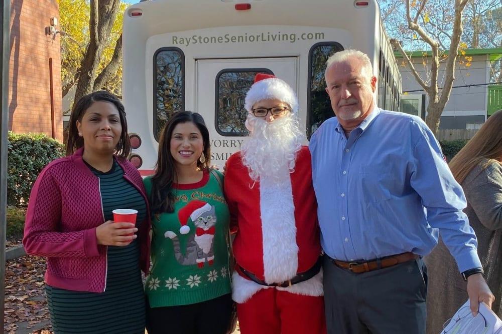 Ray Stone Inc. employee dressed as Santa Claus