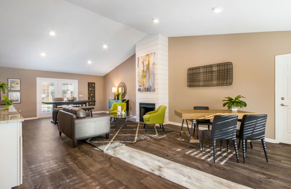 Spacious clubhouse with a fireplace for cold nights at Alexander Station Apartment Homes in Salisbury, North Carolina