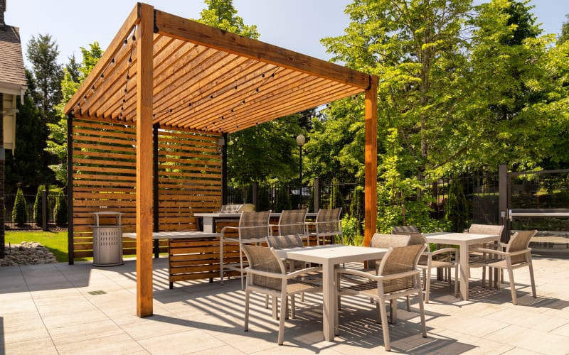Covered outdoor grilling area at Brookside Village in Auburn, Washington