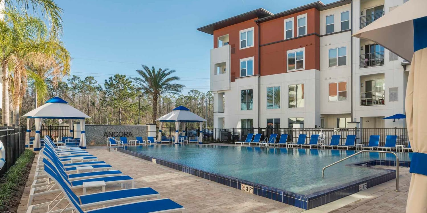 Get your laps in at Ancora Apartments' swimming pool, and there's plenty of poolside seating to relax when you're done.