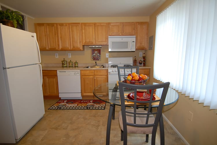 Enjoy apartments with a naturally well-lit kitchen at Gwynnbrook Townhomes