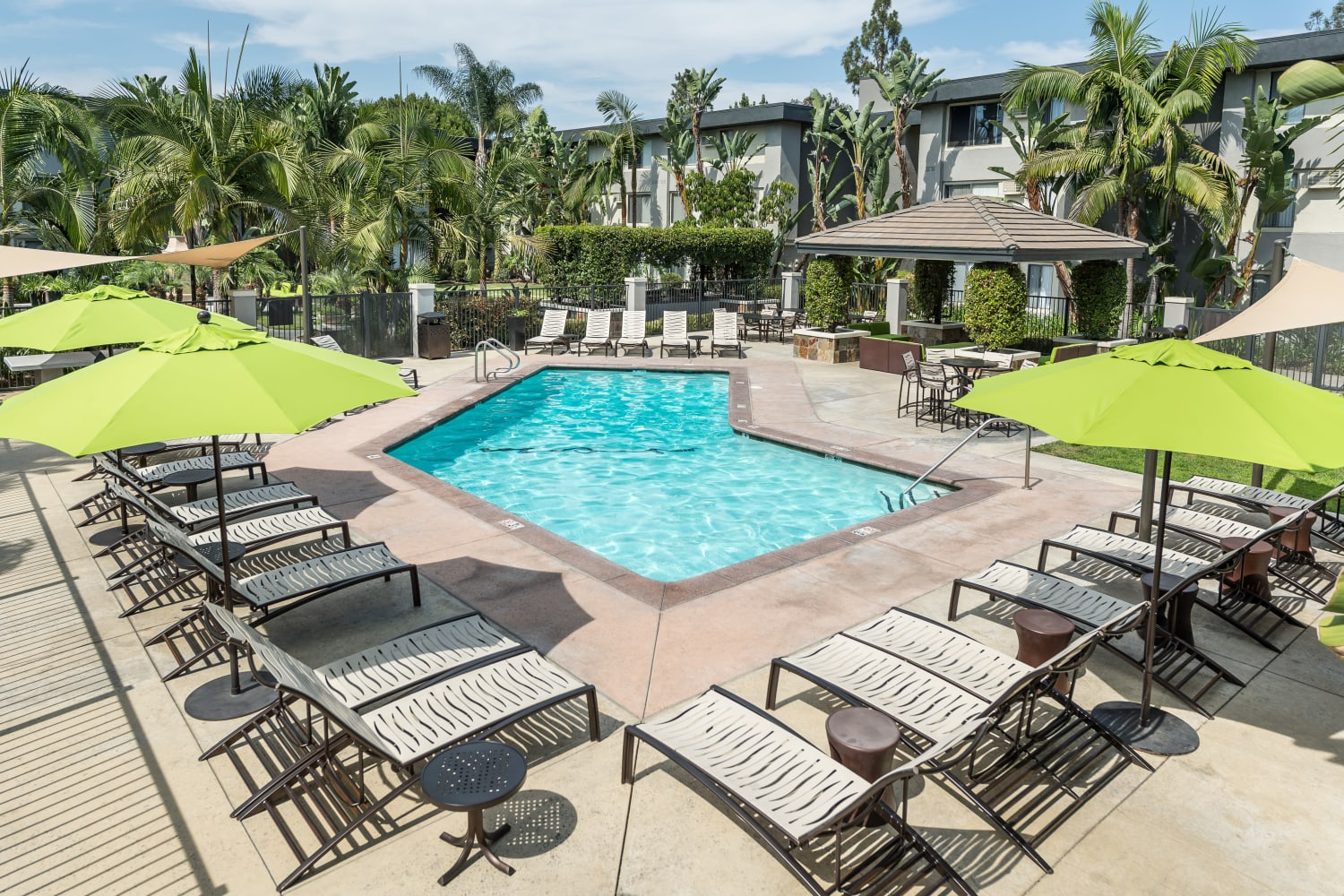 Enjoy apartments with a swimming pool at UCE Apartment Homes in Fullerton, California