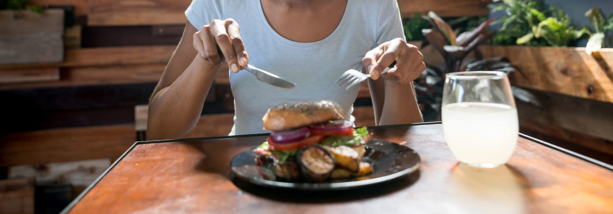 Resident enjoying a burger near San Artes in Scottsdale, Arizona