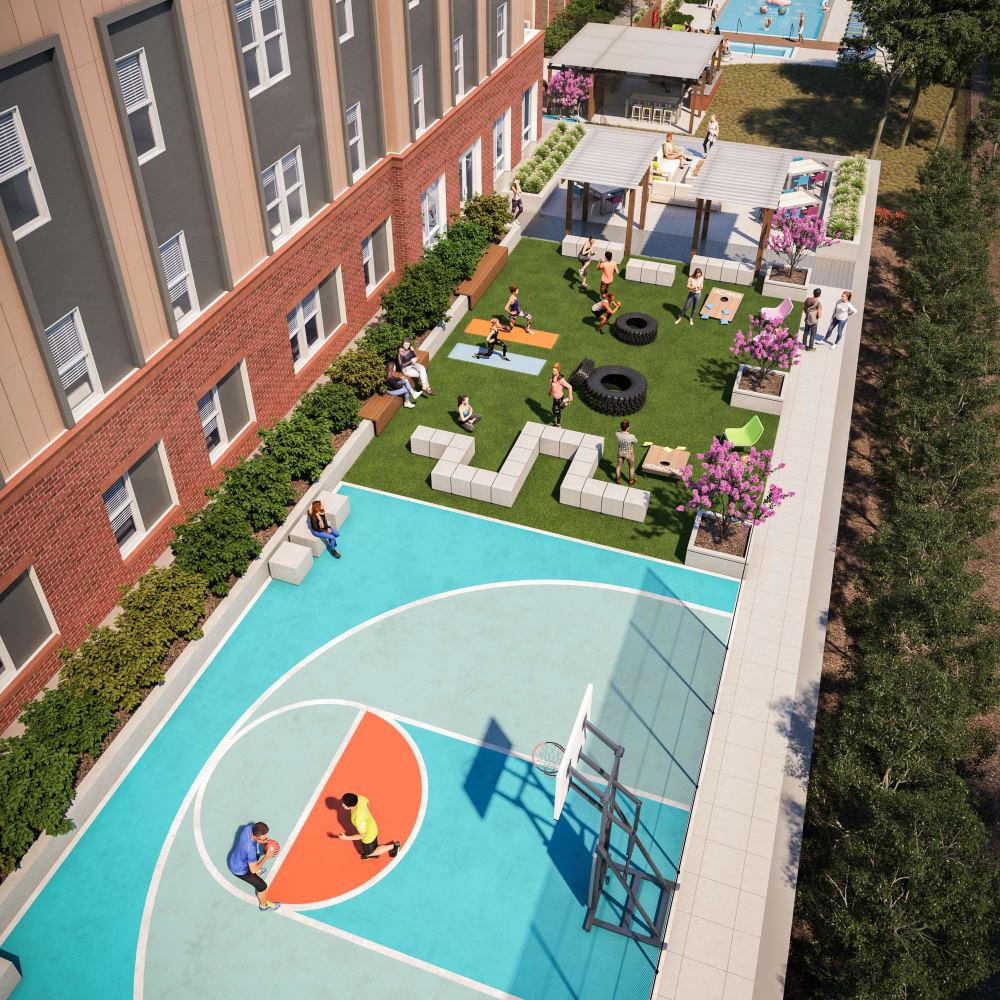 Community basketball court and outdoor workout area at UNCOMMON Raleigh in Raleigh, North Carolina