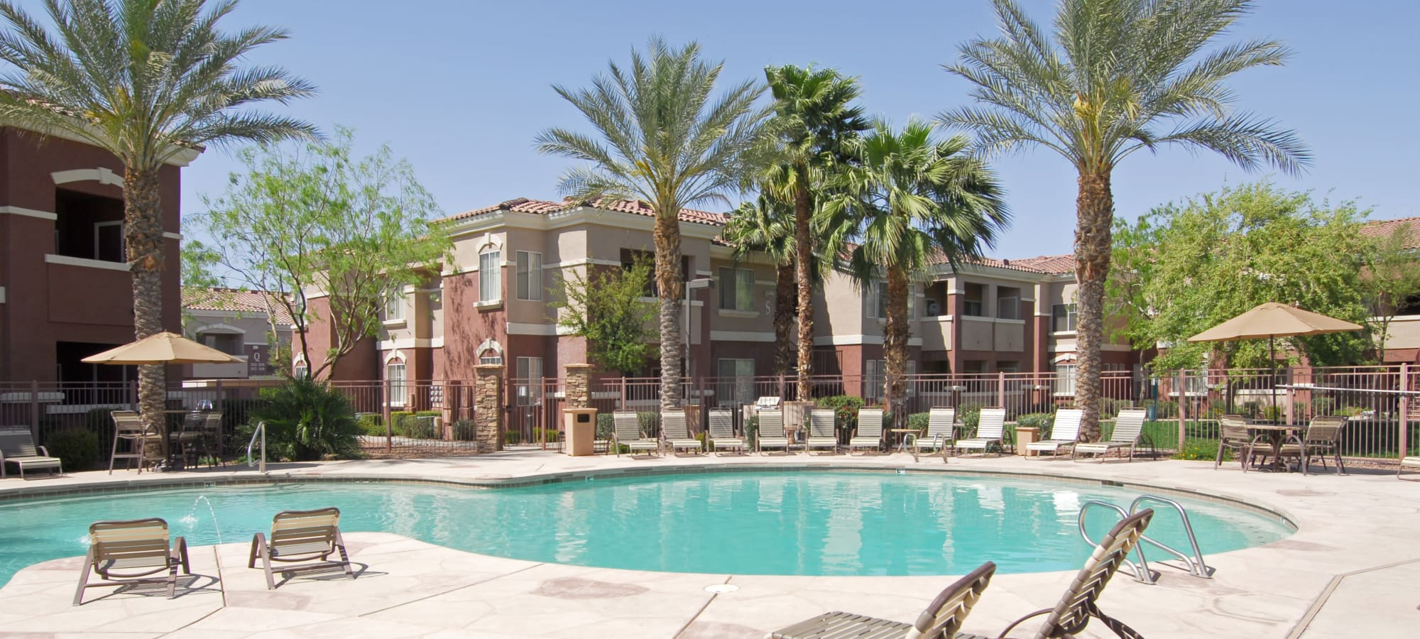 State-of-the-art swimming pool with lounge chairs at Remington Ranch in Litchfield Park, Arizona