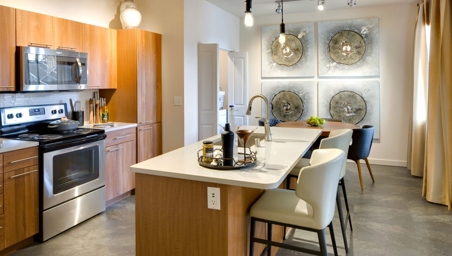 Well-equipped kitchen with quartz countertops at Olympus Alameda in Albuquerque, New Mexico