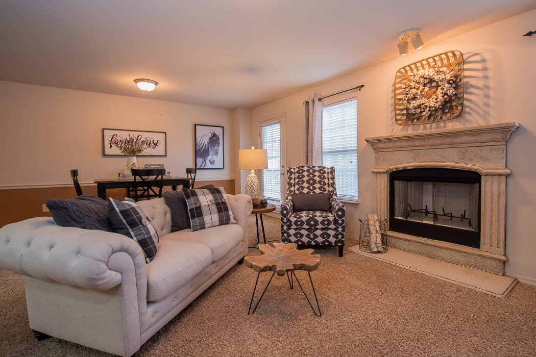 Living room with a fireplace at The Park on Westpointe in Yukon, Oklahoma