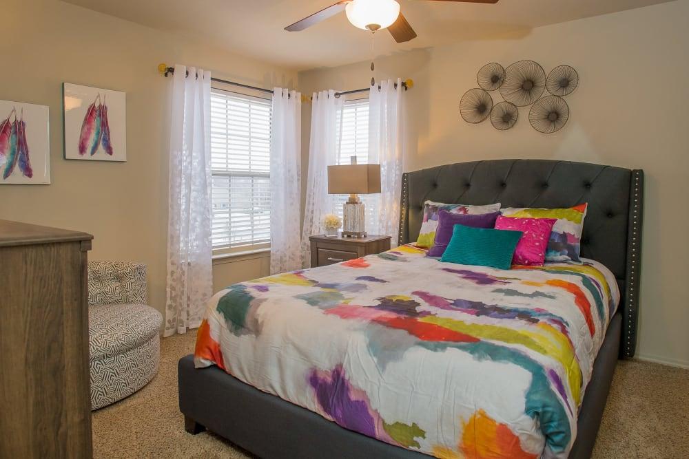 Cozy bedroom at Portofino Apartments in Wichita, Kansas