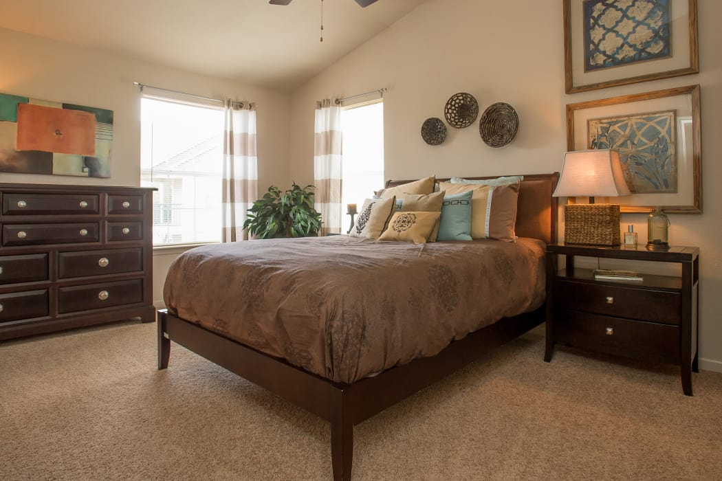 Carpeted bedroom at Villas at Stonebridge in Edmond, Oklahoma
