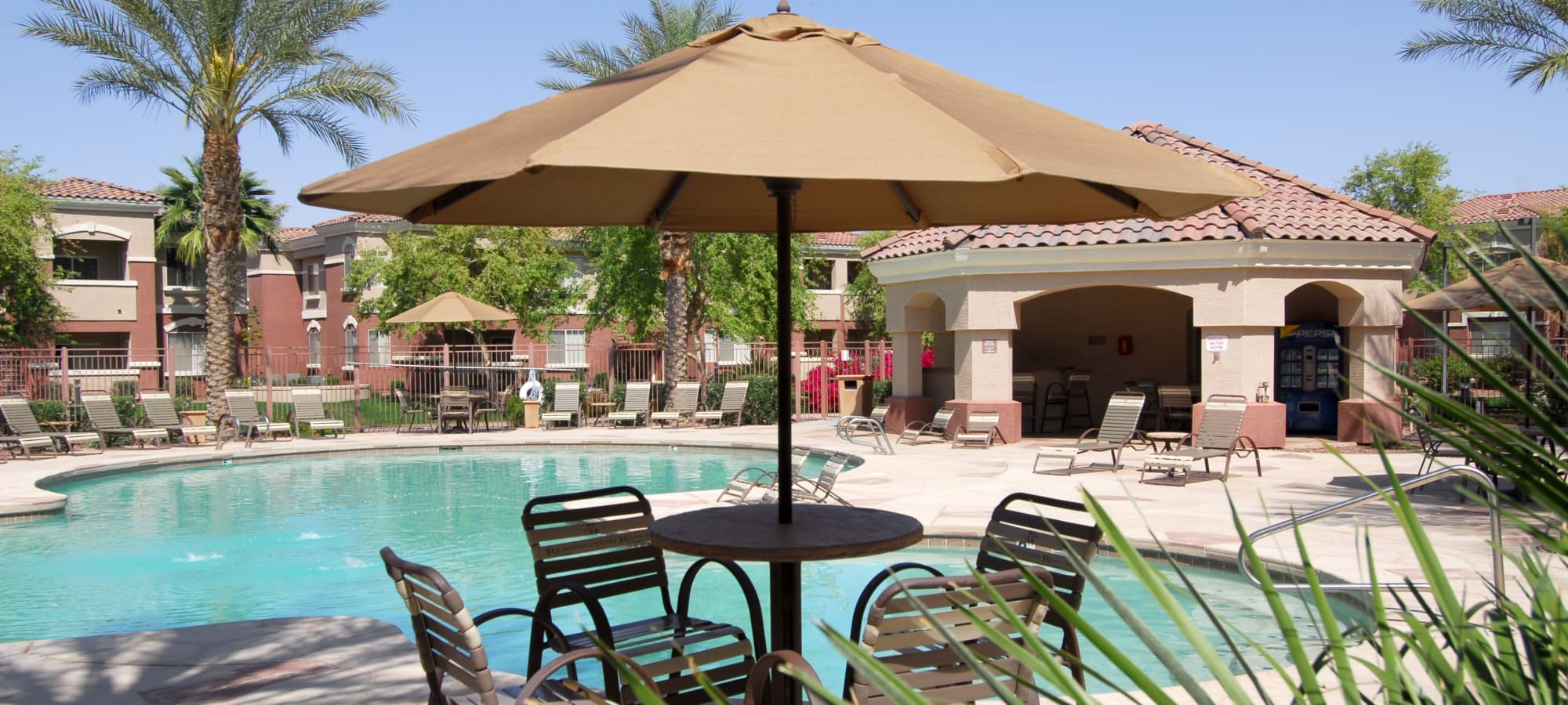 Shaded seating near the swimming pool at Remington Ranch in Litchfield Park, Arizona