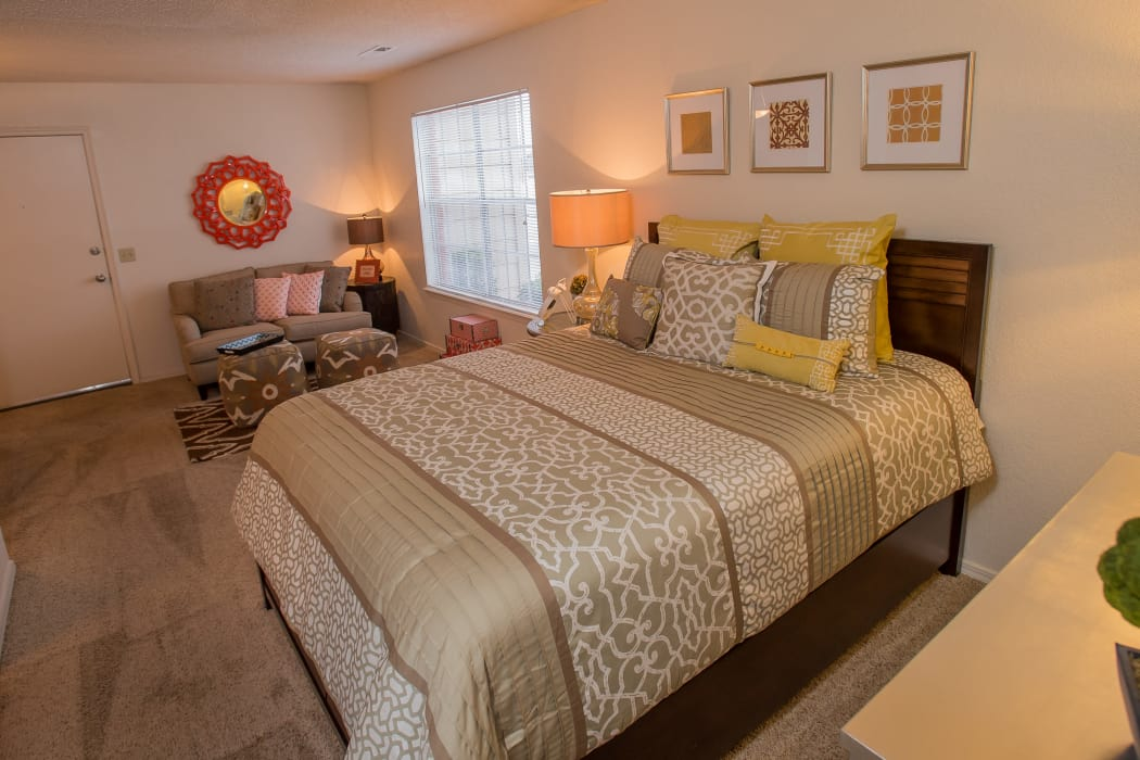 Stylish bedroom at Tammaron Village Apartments in Oklahoma City, Oklahoma