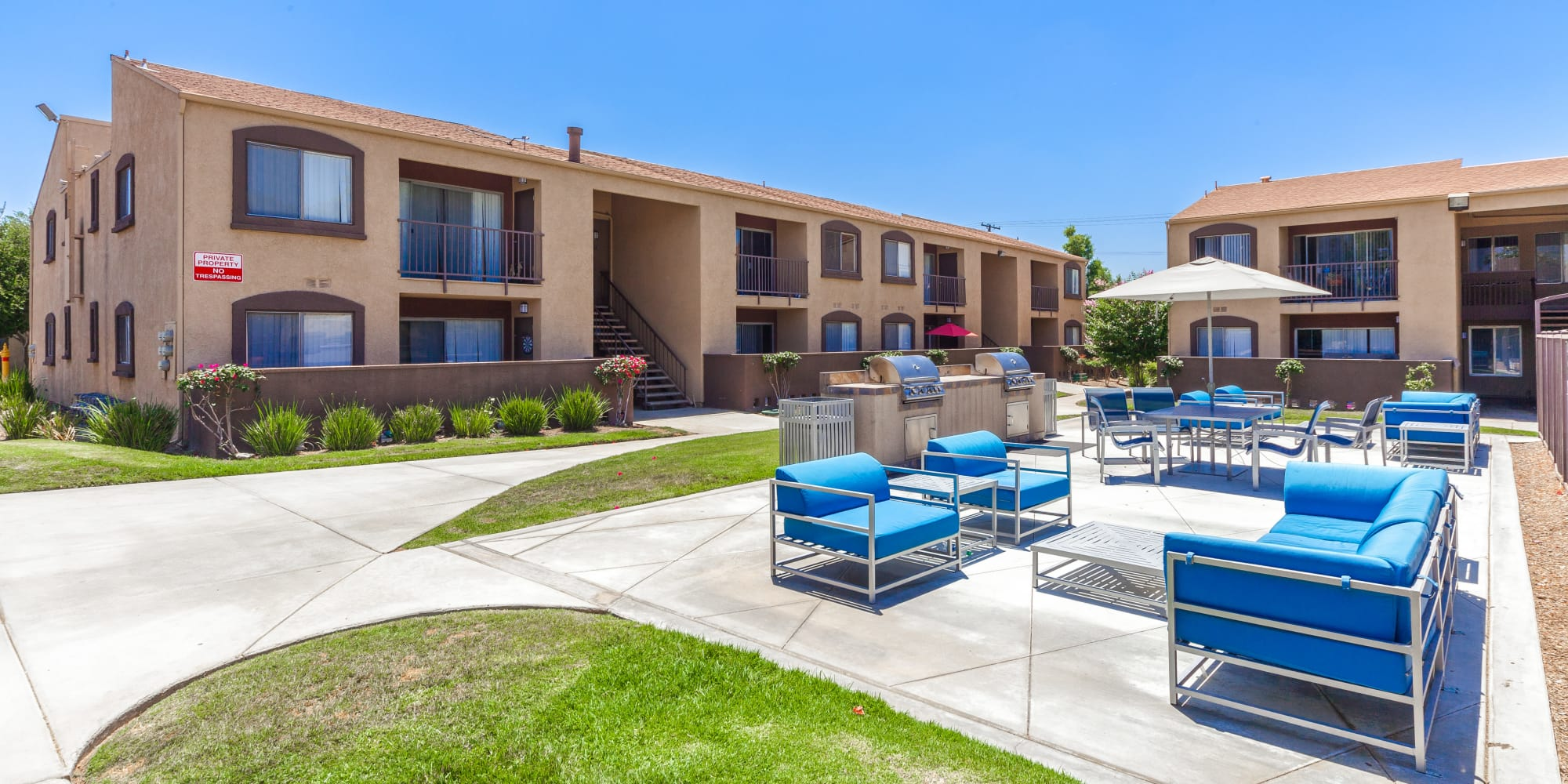 Courtyard on a beautiful sunny day at West Fifth Apartments in Ontario, California