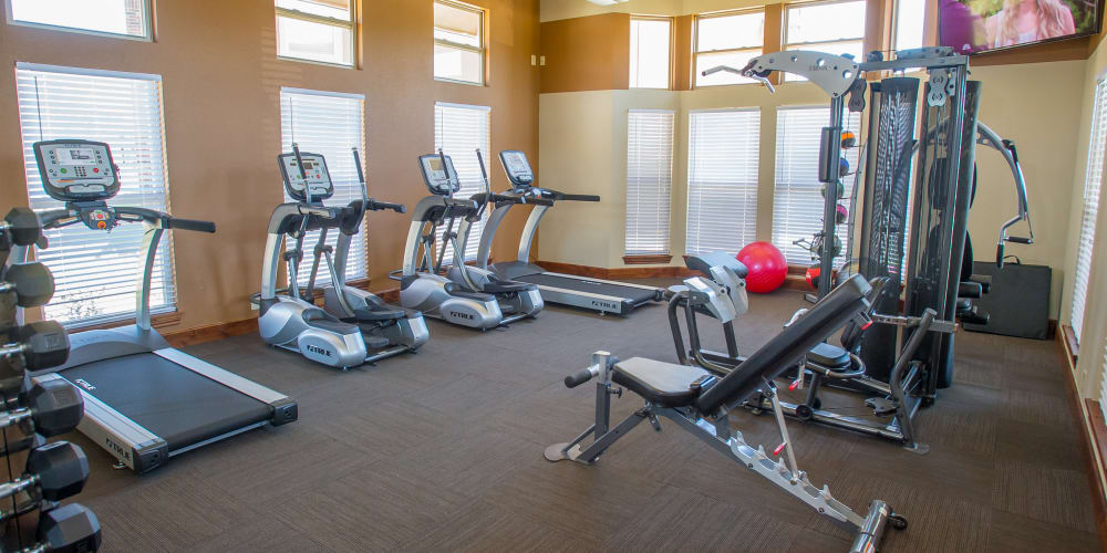 Fully equipped fitness center at The Reserve at Elm in Jenks, Oklahoma