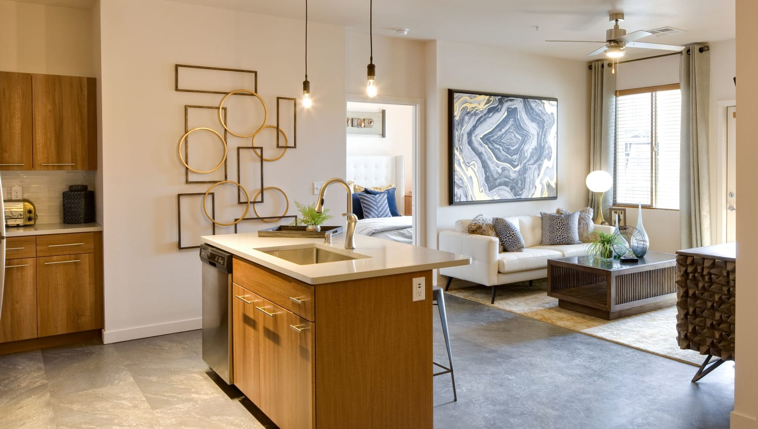Spacious kitchen and living room in a model apartment at Olympus Alameda in Albuquerque, New Mexico