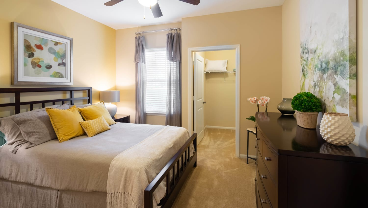 Ceiling fan and plush carpeting in a model home's bedroom at Legends at White Oak in Ooltewah, Tennessee