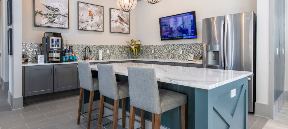 Community coffee bar and seating at South City Apartments in Summerville, South Carolina